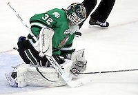 North Dakota goalie Aaron Dell stops a shot during the third period. No. 4 UNO beat No. 7 North Dakota 1-0 Saturday night at Qwest Center Omaha. (Photo by Michelle Bishop)