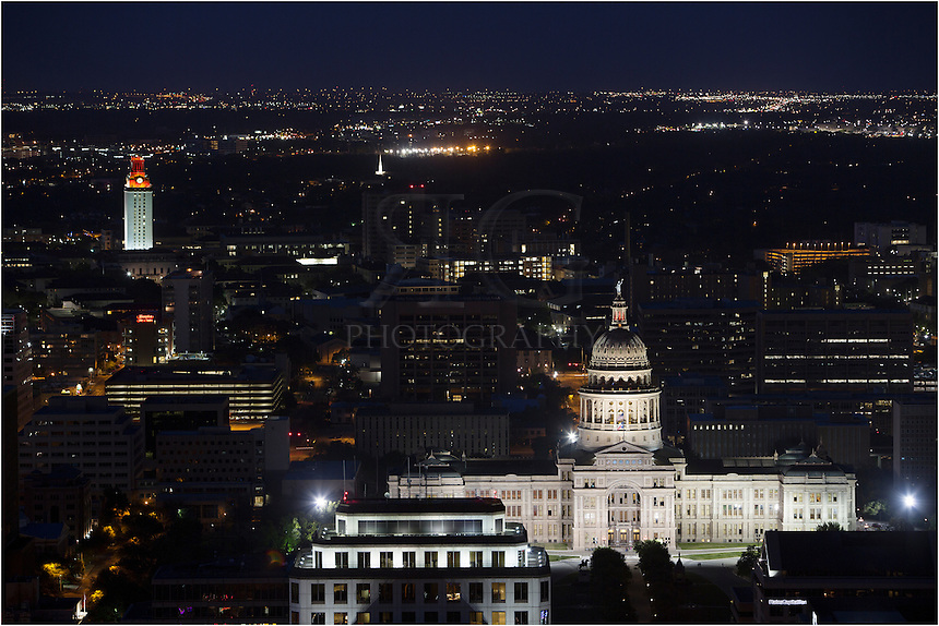 This image taken from the middle of the Austin skyline looks out at the Texas State Capitol with the University of Texas campus and tower in the distance. The UT tower glowed orange, honoring an important event (not sure what!).<br />