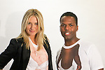 "Maria Sharapova and AJ Calloway pose together in their ""Babies On The Inside"" T-shirt during the Evian ""Live Young"" photo shoot event hosted by Maria Sharapova at Openhouse Gallery on August 24, 2010."
