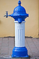 Blue and white drinking fountain water tap in Ardmore Village, County Waterford, Southern Ireland