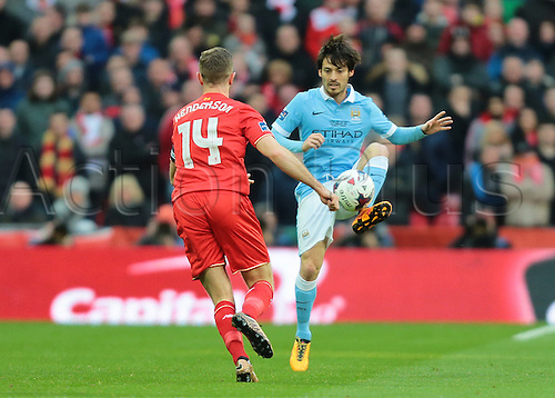 28.02.2016. Wembley Stadium, London, England. Capital One Cup Final. Manchester City versus Liverpool. Manchester City Midfielder David Silva controls a high ball as Liverpool Midfielder Jordan Henderson closes him down