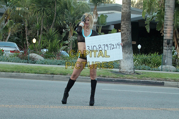 BEVERLY HILLS, CA - JANUARY 2: Nadeea Volianova starts 2015 by searching for a Billionaire to marry by walking the street with a sign, giving out her real phone number, Beverly Hills, CA January 2, 2015.  <br /> CAP/MPI/DE/DC<br /> &copy;David Edwards/DailyCeleb/MediaPunch/Capital Pictures
