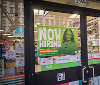 A sign in the window of a 7-Eleven convenience store in New York advises potential job applicants of the opportunities available, seen on Thursday, April 7, 2016.  (© Richard B. Levine)