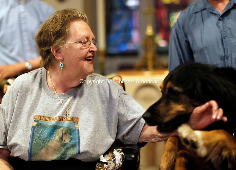 Waterbury, CT-22, May 2010-052210CM17  Jo-Anne Plunske is greeted by Tracker, a 5 year old mixed Gordon Setter and Saint Benard, at the St. John Episcopal Church in downtown Waterbury Saturday afternoon. Tracker and owner, Bill Walters, of Plymouth paid their respects to  Luke III, a Golden Retriever service dog, who passed away on recently.  -Christopher Massa Republican-American