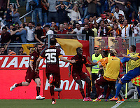 Calcio, Serie A: Lazio vs Roma. Roma, stadio Olimpico, 25 maggio 2015.<br /> Roma's Mapou Yanga-Mbiwa, center, celebrates after scoring the winning goal during the Italian Serie A football match between Lazio and Roma at Rome's Olympic stadium, 25 May 2015. Roma won 2-1.<br /> UPDATE IMAGES PRESS/Isabella Bonotto