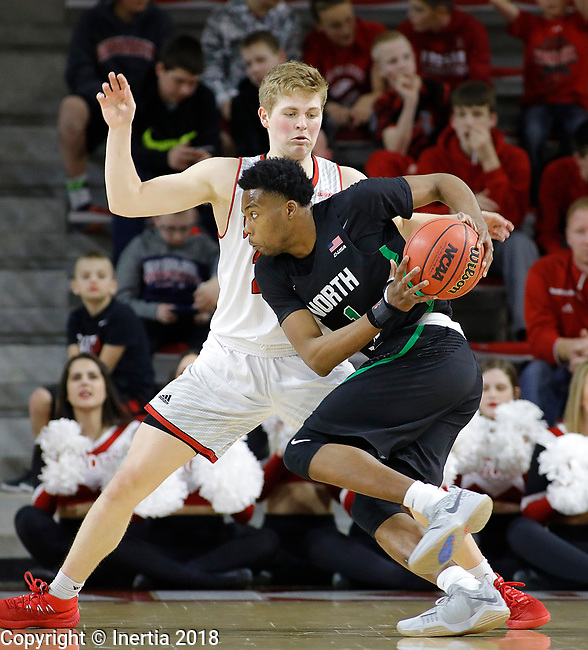 VERMILLION, SD: MARCH 14:  A.J. Lawson #1 of North Texas drives toward Tyler Peterson #22 of South Dakota during the 2018 CBI Basketball Tournament at the Sanford Coyote Sports Center in Vermillion, S.D.  (Photo by DIck Carlson/Inertia)