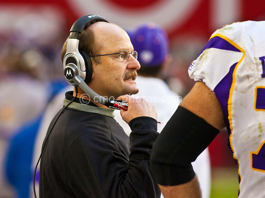 Dec 14, 2008; Glendale, AZ, USA; Minnesota Vikings head coach Brad Childress talks to offensive guard Steve Hutchinson (right) on the sidelines in the fourth quarter of a game against the Arizona Cardinals at University of Phoenix Stadium.  The Vikings won the game 35-14.