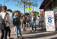 Mark Vallianatos, Policy Director, Urban & Environmental Policy Institute and adjunct professor, Urban & Environmental Policy, with his class, UEP 210 Transportation & Living Streets on a walking tour of Highland Park along Figueroa, Oct. 29, 2015.<br /> (Photo by Marc Campos, Occidental College Photographer)