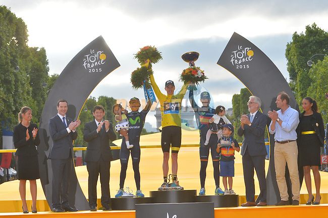 Overall Yellow Jersey winner Christopher Froome (GBR) Team Sky with 2nd place Nairo Quintana (COL) and 3rd Alejandro Valverde (ESP) Movistar on the podium in Paris at the end of Stage 21 of the 2015 Tour de France running 109.5km from Sevres to Paris - Champs Elysees, France. 26th July 2015.<br /> Photo: ASO/B.Bade/Newsfile