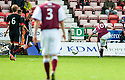 Arbroath's Steven Milne scores their first goal.