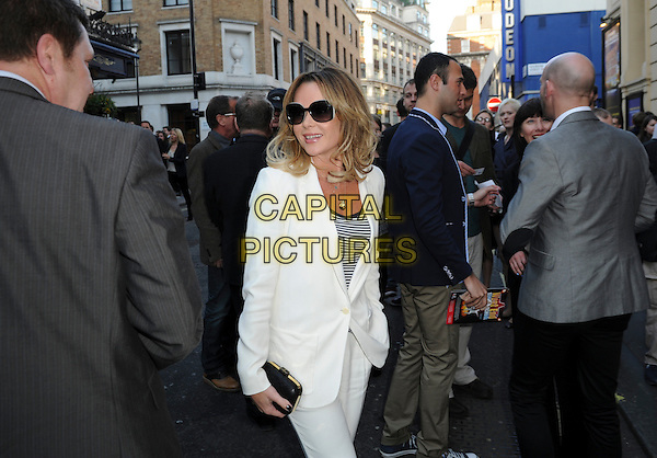 Amanda Holden.'Merrily We Roll Along' Press Night at the Harold Pinter Theatre, London, England..May 1st 2013.half length white suit sunglasses shades black clutch bag stripe top .CAP/GM/PP.©Gary Mitchell/PP/Capital Pictures.