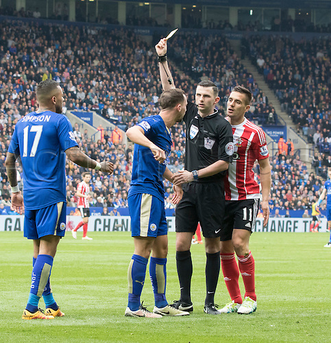 03.04.2016. King Power Stadium, Leicester, England. Barclays Premier League. Leicester versus Southampton.  Leicester City midfielder Danny Drinkwater receives a yellow card from Referee Mr. Michael Oliver after a foul on Southampton midfielder Dusan Tadic.