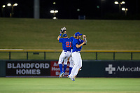AZL Cubs outfielders (from left to right) Jose Gutierrez (91), Jonathan Sierra (22), and Kwang-Min Kwon (27) celebrate after winning a game against the AZL Brewers on August 6, 2017 at Sloan Park in Mesa, Arizona. AZL Cubs defeated the AZL Brewers 8-7. (Zachary Lucy/Four Seam Images)