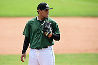 Clinton LumberKings pitcher Carlos Misell (34) looks in for the sign during a game against the Beloit Snappers on August 17, 2014 at Ashford University Field in Clinton, Iowa.  Clinton defeated Beloit 4-3.  (Mike Janes/Four Seam Images)