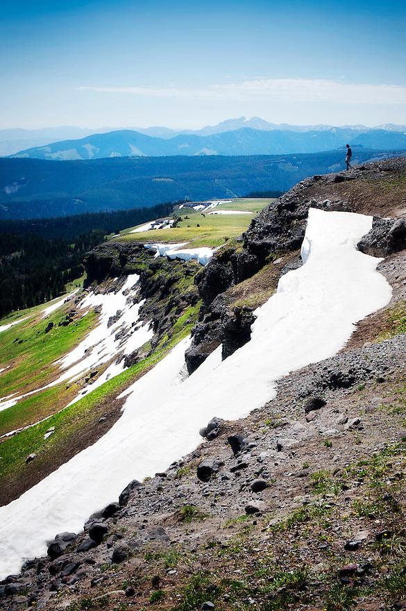 A hiker walks along the crest of the Gallatin Mountain Range at Windy Pass near Big Sky, Montana.