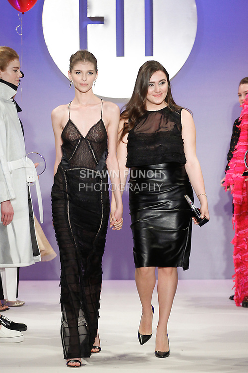 Student fashion designer Joelle Samaha wins the Special Occasion Critic Award, and walks runway with model, during the FIT Future of Fashion 2014 Graduates' Collection fashion show, at the Fashion Institute of Technology on May 1, 2014.