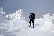 Appalachian Trail - A hiker on the summit of Carter Dome in winter conditions. Located in the White Mountains, New Hampshire USA