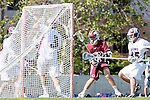 Los Angeles, CA 03/16/10 - Trevor Stotka (Chico State # 38), Cyrus Pura (LMU # 15) and Thomas Holman (LMU # 3) in action during the Chico State-Loyola Marymount University MCLA interdivisional game at Leavey Field (LMU).  LMU defeated Chico State 7-4.