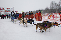 Michael Owens of Nome leaves the start line of the 2009 Junior Iditarod on Knik Lake on Saturday Februrary 28, 2009.