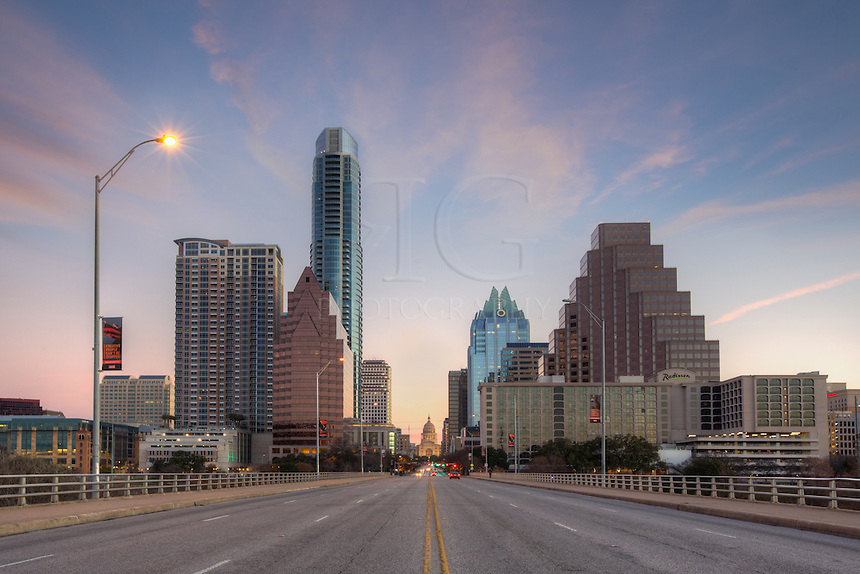 Austin, Texas was beginning to come to life on this cold winter morning. In this photograph taken from the middle of Congress Avenue, the skyline formed a corridor that lead straigth to the state capitol. This is one of the iconic views of the city.
