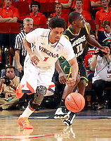 CHARLOTTESVILLE, VA- DECEMBER 6: Jontel Evans #1 of the Virginia Cavaliers steals the ball from Vertrail Vaughns #11 of the George Mason Patriots during the game on December 6, 2011 at the John Paul Jones Arena in Charlottesville, Virginia. Virginia defeated George Mason 68-48. (Photo by Andrew Shurtleff/Getty Images) *** Local Caption *** Jontel Evans;Vertrail Vaughns