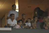 David Beckham holds his son Romeo as family and friends, including Phil Neville, watch the LA Galaxy of MLS defeat CF Pachuca of the Mexican First Division 2-1 during an opening round SuperLiga match at the Home Depot Center, Carson, CA, on July 24, 2007.