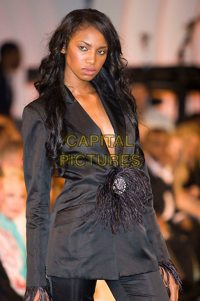 """MODEL.Hollyrod's Designcure Celebrates It's """"Lucky Seven"""" with Performances & and Featuring Fashion Show held at the home of Sugar Ray Leonard, Pacific Palisades, California..July 9th, 2005.Photo Credit: Zach Lipp/AdMedia.half length black jacket plunging neckline feathers clasp.www.capitalpictures.com.sales@capitalpictures.com.© Capital Pictures."""