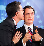 UNITED STATES - NOVEMBER 16: Comedian Stephen Colbert licks himself during the unveiling of his wax figure at the Madame Tussauds wax museum in Washington on Friday, Nov. 16, 2012. (Photo By Bill Clark/CQ Roll Call)