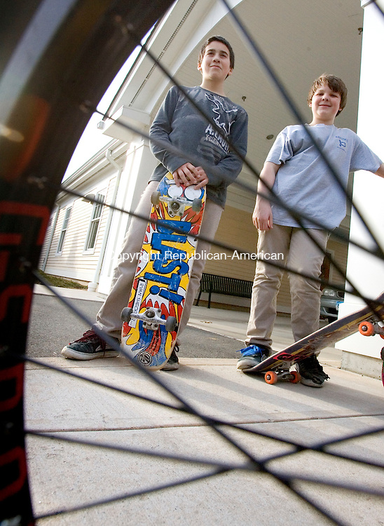 WOODBURY, CT. 08 March 2012-030812SV06- From left, Liam Hoyt, 13, and Tristan Klimak, 13, both of Woodbury hang out with friends skateboarding at the senior center in Woodbury Thursday. Teens and their parents are lobbying the town for a skate park with the backing of the first selectman..Steven Valenti Republican-American