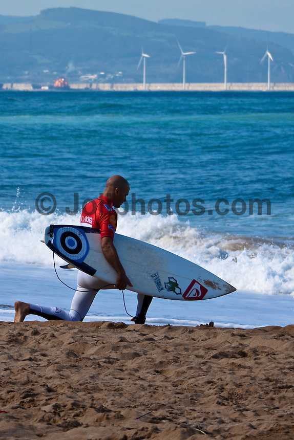 KELLY SLATER (USA)   De Souza Takes Inaugural ASP World Tour Win at Billabong Pro Mundaka..SOPELANA, Euskadi/Spain (Tuesday, October 13, 2009) - Adriano de Souza (BRA), 22, claimed his inaugural ASP World Tour win today, taking out the Billabong Pro Mundaka, eliminating fellow Finalist Chris Davidson (AUS), 33, in punchy two-to-three foot (1 metre) waves at the backup venue of Sopelana...Stop No. 8 of 10 on the 2009 ASP World Tour, the Billabong Pro Mundaka experienced an array of conditions for the event, from clean surf on the opening day at Mundaka to a lengthy seven-day wait before a marathon 24-heat session yesterday, culminating into today's dramatic finale...De Souza, who had previously experienced in the ASP World Junior Championships (winning in 2003) and on the ASP World Qualifying Series winning in 2005), was rapt with his inaugural ASP World Tour victory..Photo: Joliphotos.com