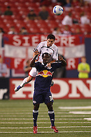 New England Revolution defender (6) Jay Heaps goes over New York Red Bulls forward (30) Francis Doe on a header. The New York Red Bulls and the New England Revolution played to a 2-2 tie in an MLS regular season match at Giants Stadium in East Rutherford, NJ, on September 22, 2007.