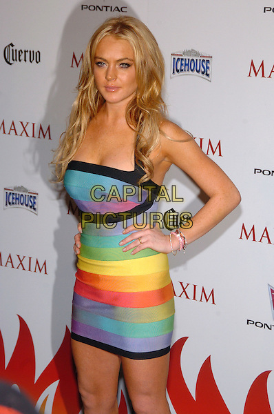 LINDSAY LOHAN.Maxim Magazine's 8th Annual Hot 100 Party at Gansevoort Hotel, New York City, New York, USA..May 16th, 2007.half length black trim blue purple yellow green tight dress hand on hip bracelets .CAP/ADM/BL.©Bill Lyons/AdMedia/Capital Pictures *** Local Caption ***