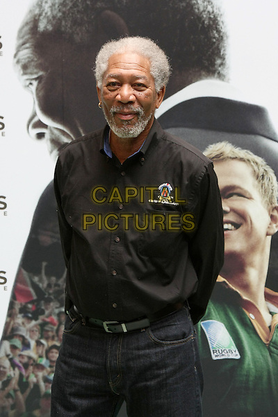 "MORGAN FREEMAN.Photocall for ""Invictus"", Rome, Italy..February 4th, 2010.half length black suit beard facial hair jeans denim .CAP/CAV.©Luca Cavallari/Capital Pictures."