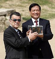 Minos Kyriakou with Liu Chi in ancient Olympia, Greece.