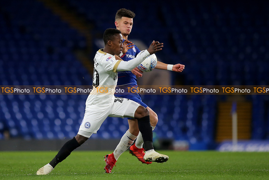 Siriki Dembele of Peterborough and Chelsea's George McEachran challenge for the ball during Chelsea Under-21 vs Peterborough United, Checkatrade Trophy Football at Stamford Bridge on 9th January 2019