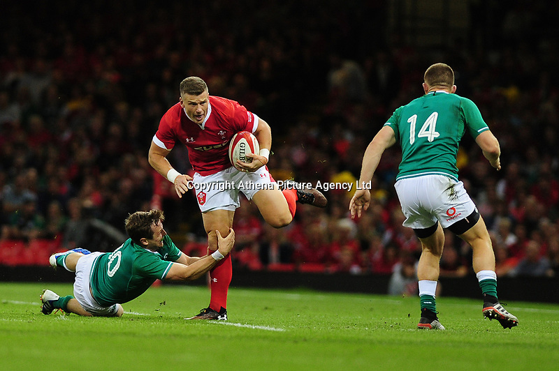 Scott Williams of Wales evades the tackle of Jack Carty of Ireland during the under armour summer series 2019 match between Wales and Ireland at the Principality Stadium, Cardiff, Wales, UK. Saturday 31st August 2019