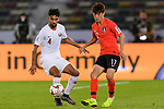 Lee Chungyong of South Korea (R) fights for the ball with Tarek Salman of Qatar (L) during the AFC Asian Cup UAE 2019 Quarter Finals match between Qatar (QAT) and South Korea (KOR) at Zayed Sports City Stadium  on 25 January 2019 in Abu Dhabi, United Arab Emirates. Photo by Marcio Rodrigo Machado / Power Sport Images