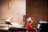 "Musicians Duane Sullivan (right) and Pamela Nichols (not pictured), both of Belmont, Mass., prepare hymns for the service at St. Frances Xavier Cabrini Church in Scituate, Mass., on Sun., May 29, 2016. Members of the congregation have been holding a vigil for more than 11 years after the Archdiocese of Boston ordered the parish closed in 2004. For 4234 days, at least one member of Friends of St. Frances X. Cabrini has been at the church at all times, preventing the closure of the church. May 29, 2016, was the last service held at the church after members finally agreed to leave the building after the US Supreme Court decided not to hear their appeal to earlier an Massachusetts court ruling stating that they must leave. The last service was called a ""transitional mass"" and was the first sanctioned mass performed at the church since the vigil began."