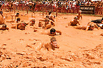June 1, 2013. Huntersville, North Carolina<br />  The final obstacle was a crawl through a sticky red mud pit, where several contestants had to be pulled from after they got stuck.<br />  A North Carolina chapter of The Warrior Dash, which consists of a 5k run/walk broken up by several obstacles, was held over the weekend with thousands turning out to test their abilities in a race against the clock and each other. Participants in all age groups were sent out in heats over the course of the entire day.
