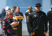 Mar 14, 2014; Gainesville, FL, USA; Jesse James (right), husband of NHRA funny car driver Alexis DeJoria (not pictured) and Connie Kalitta watch during qualifying for the Gatornationals at Gainesville Raceway Mandatory Credit: Mark J. Rebilas-USA TODAY Sports