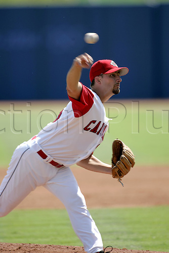 25 August 2004: Canadian pitcher MIKE JOHNSON (CAN) pitches during the third place Baseball game against Japan at The 2004 Olympic Games, Athens, Greece. Japan beat Canada 11 - 2 Photo: Glyn Kirk/Action Plus...040825 olympics player pitch