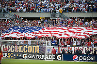 USA fans with American flag. The USA defeated Honduras, 2-1, in a World Cup qualifying match at Soldier Field in Chicago, IL on June 6, 2009.