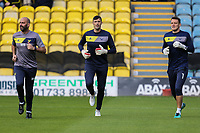 Oxford United goalkeepers, Simon Eastwood (right) and Scott Shearer of Oxford United (centre) warm up ahead of the Sky Bet League 1 match between Peterborough and Oxford United at the ABAX Stadium, London Road, Peterborough, England on 30 September 2017. Photo by David Horn.