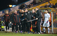 Mansfield Town assistant manager Paul Rayner & the coaching staff as Scott Kashket of Wycombe Wanderers prepares to come on during the The Checkatrade Trophy  Quarter Final match between Mansfield Town and Wycombe Wanderers at the One Call Stadium, Mansfield, England on 24 January 2017. Photo by Andy Rowland.