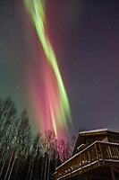 The aurora borealis hovers over a home in Fairbanks, Alaska.