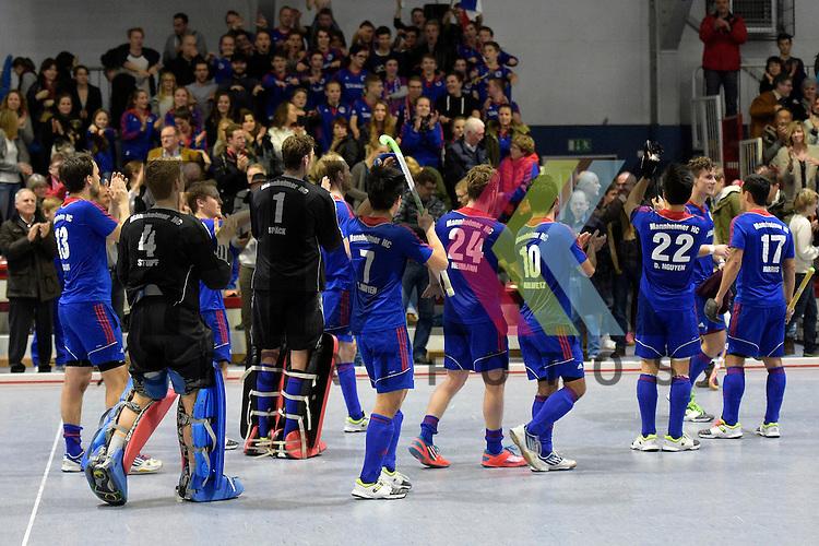 GER - Mannheim, Germany, January 10: Players of Mannheimer HC celebrate after winning the 1. Bundesliga Sued Herren indoor hockey match between TSV Mannheim (red) and Mannheimer HC (blue) on January 10, 2016 at TSV Mannheim in Mannheim, Germany. Final score 5-9 (HT 3-7). <br /> <br /> Foto &copy; PIX-Sportfotos *** Foto ist honorarpflichtig! *** Auf Anfrage in hoeherer Qualitaet/Aufloesung. Belegexemplar erbeten. Veroeffentlichung ausschliesslich fuer journalistisch-publizistische Zwecke. For editorial use only.