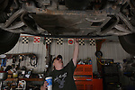 Rick Woods inspects the belly of his Ford 150 as Crisp builds and welds him a mufler. He ended up spending the day at the shop; relaxing and joking with the customers and friends that stopped in. Woods ended up not having the cash needed yet, but left with his car and paid the next day.