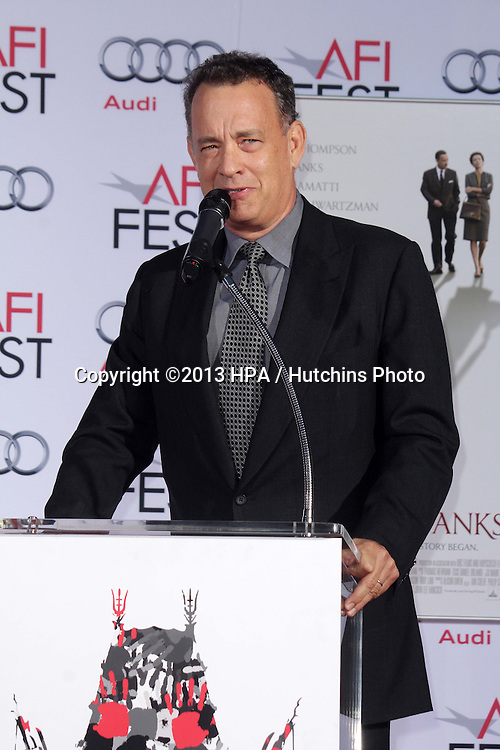 LOS ANGELES - NOV 7:  Tom Hanks at the Emma Thompson Hand and Footprint Ceremony at TCL Chinese Theater on November 7, 2013 in Los Angeles, CA\