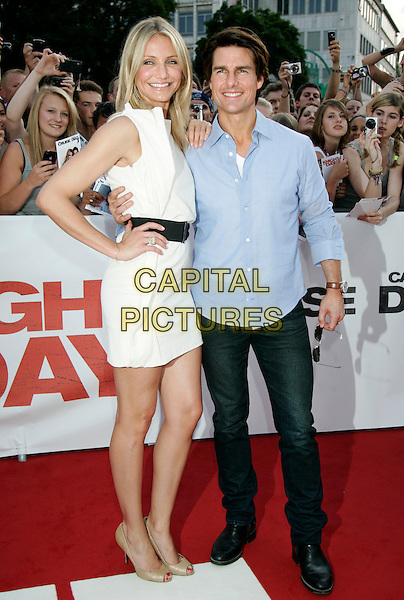 "CAMERON DIAZ & TOM CRUISE.""Knight And Day"" German Film  Premiere, Munich, Germany, .July 21st, 2010.full length white dress sleeveless shift cream hand on hip black waist belt blue shirt  peep toe beige shoes .CAP/PE.©Peter Eden/Capital Pictures."