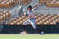 Mesa Solar Sox left fielder Daniel Woodrow (19), of the Detroit Tigers organization, follows through on his swing during an Arizona Fall League game against the Glendale Desert Dogs at Camelback Ranch on October 15, 2018 in Glendale, Arizona. Mesa defeated Glendale 8-0. (Zachary Lucy/Four Seam Images)